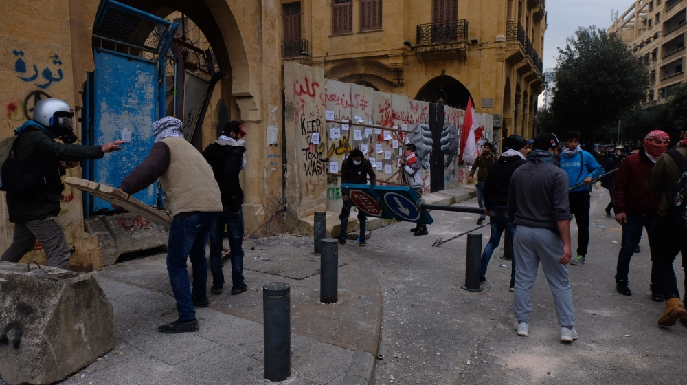 Protesters attempt to break into Beirut's Nejmeh Square, the seat of parliament.