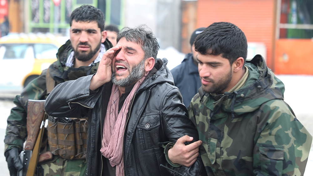 An Afghan man reacts near the site of a suicide attack in Kabul, Afghanistan February 11, 2020.REUTERS/Omar Sobhani
