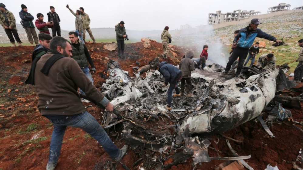 Syrian military helicopter shot down as fighting intensifies thumbnail