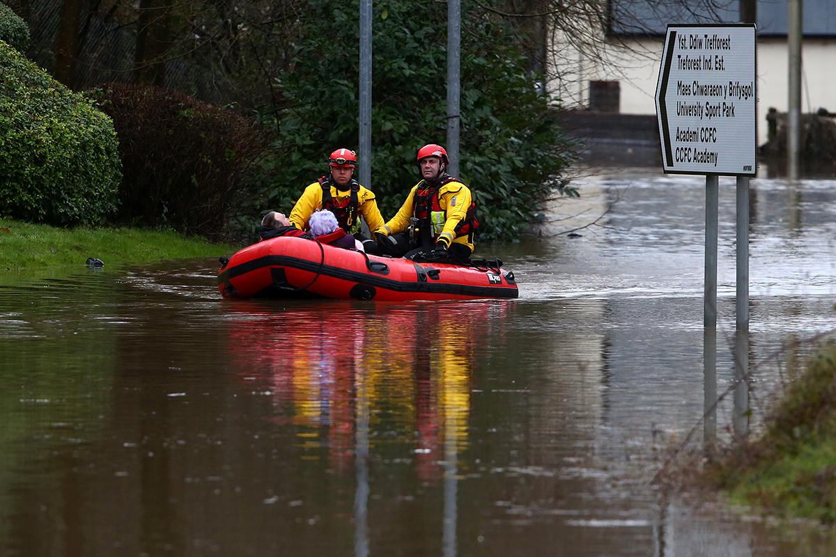 Torrential rain caused rivers in south Wales to overflow, requiring the rescue of stranded residents. [Geoff Caddick/AFP]