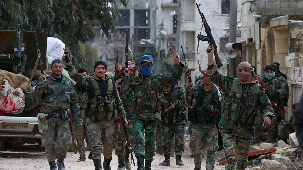 Members of the Syrian army deploy in the al-Rashidin 1 district, in Aleppo's southwestern countryside, on February 16, 2020. - Syrian regime forces made new gains in their offensive against the last m