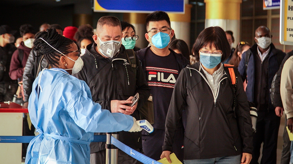 Passengers arriving on a China Southern Airlines flight from Changsha in China are screened for the new type of coronavirus, whose symptoms are similar to the cold or flu and many other illnesses, upo