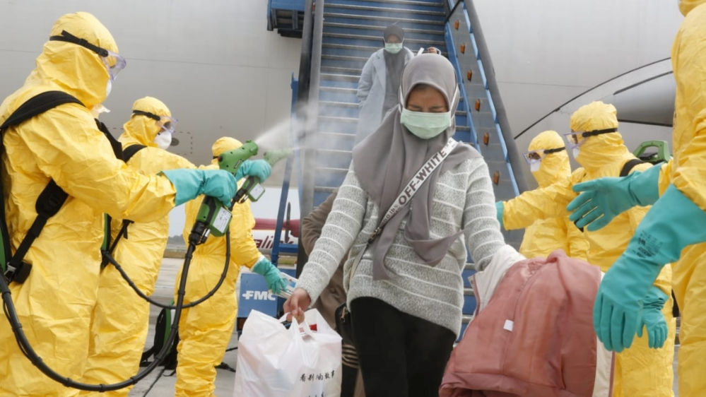 Medical officers prepare evacuated Indonesian nationals from Wuhan, China's center of the coronavirus epidemic, before transferring them to the Natuna Islands military base to be quarantined, at Hang