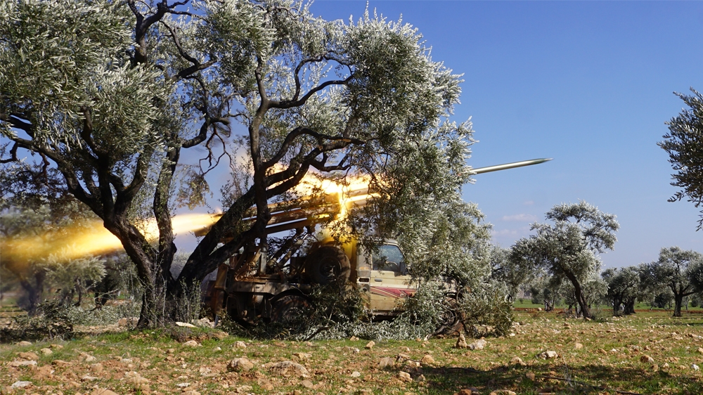 SYRIA-CONFLICT-IDLIB  Members of Syria's opposition National Liberation Front remotely-fire a rocket at a position near the village of al-Nayrab, about 14 kilometres southeast of the city of Idlib