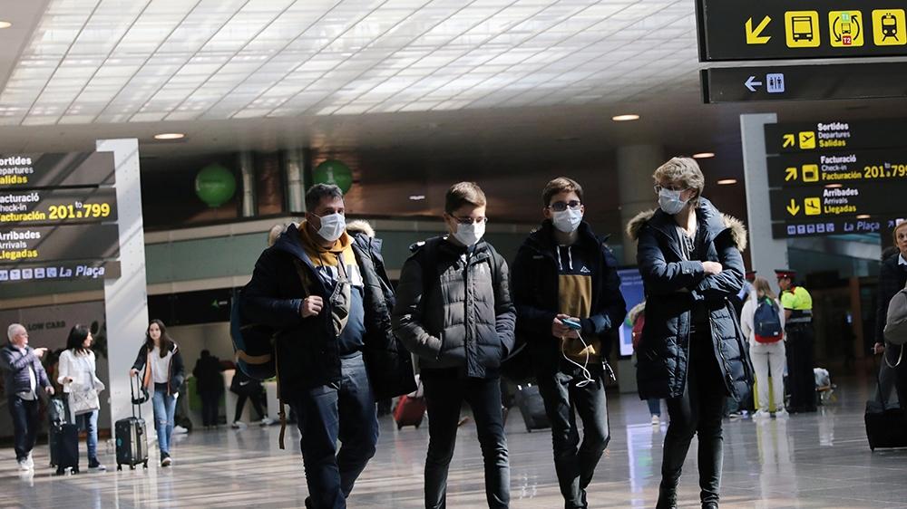A family from France arrives at Josep Tarradellas Barcelona-El Prat Airport from Venezia, before traveling towards France, where cases of novel coronavirus has been confirmed in Barcelona, Spain Febru