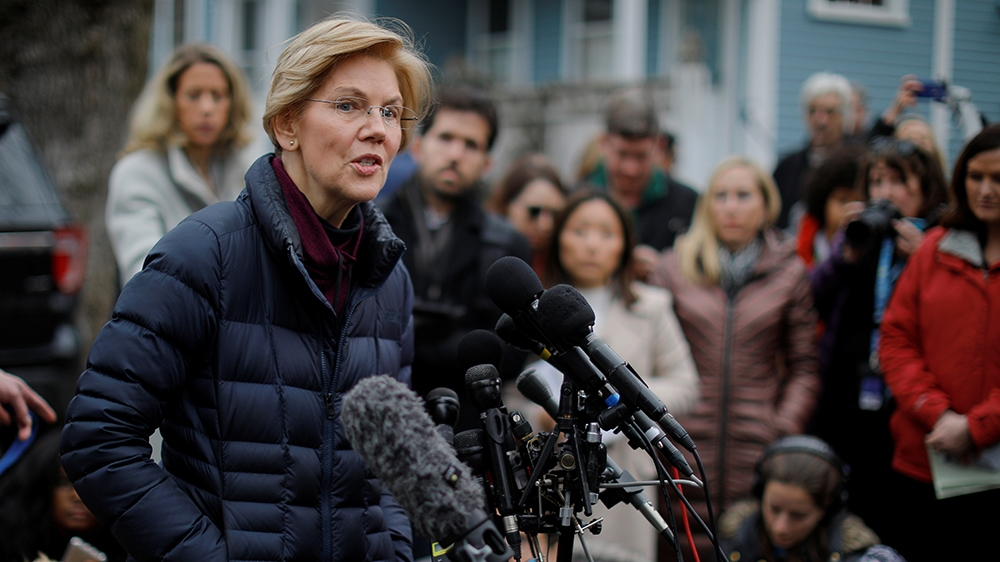 U.S. Senator Elizabeth Warren (D-MA) speaks to reporters, after announcing she has formed an exploratory committee to run for president in 2020, outside her home in Cambridge, Massachusetts, U.S., Dec