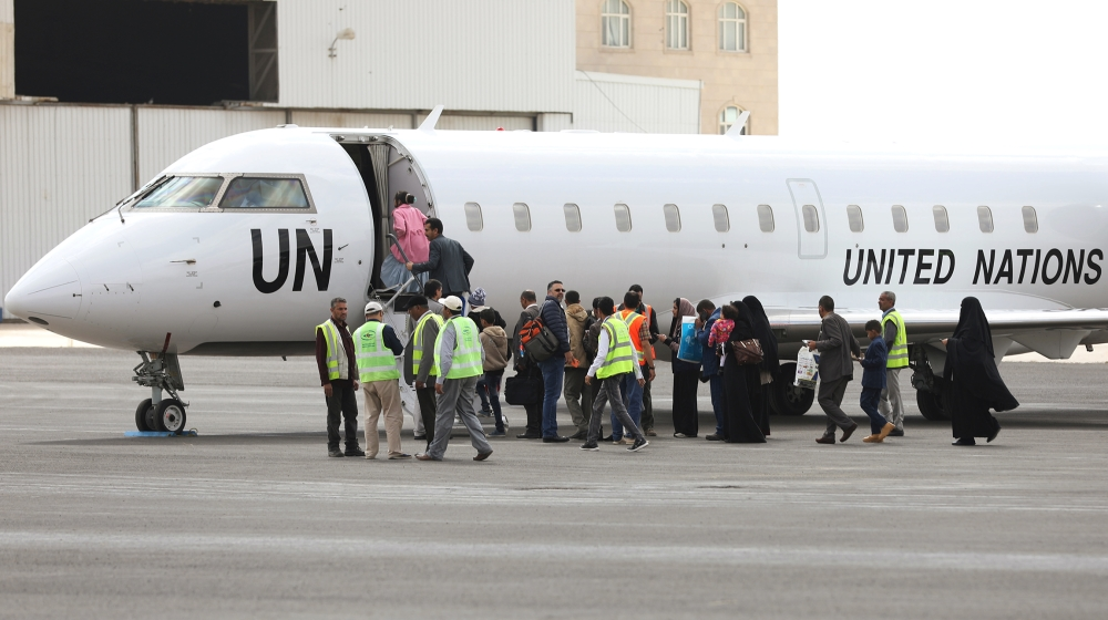People board a United Nations plane which will carry them to Amman, Jordan in the first flight of a medical air bridge from Sanaa airport in Sanaa, Yemen February 3, 2020. REUTERS/Khaled Abdullah