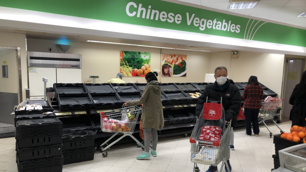 Empty Chinese vegetable shelves in Hong Kong supermarket