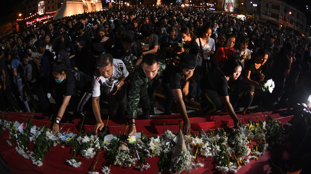 People lay down flowers at a vigil for victims following a deadly mass shooting in Nakhon Ratchasima on February 9, 2020. A Thai soldier who killed at least 26 people before being shot dead in a mall