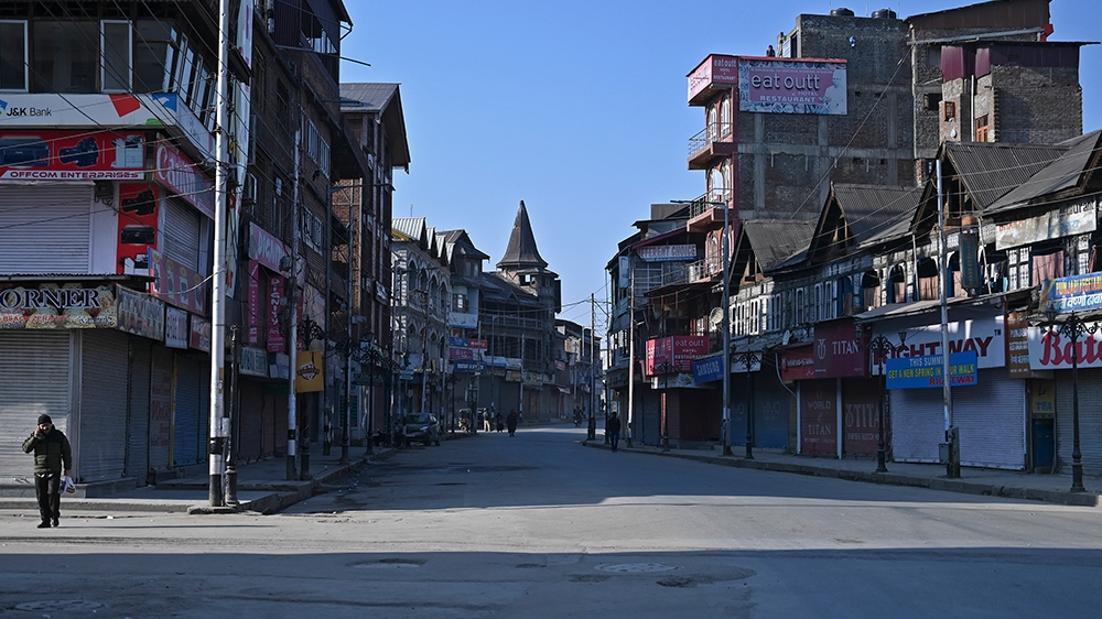 Kashmiri pedestrian walks along a street in central Lal Chowk area during a one-day strike called by Jammu and Kashmir Libration Front (JKLF) to demand the return of the remains of Afzal Guru, who was