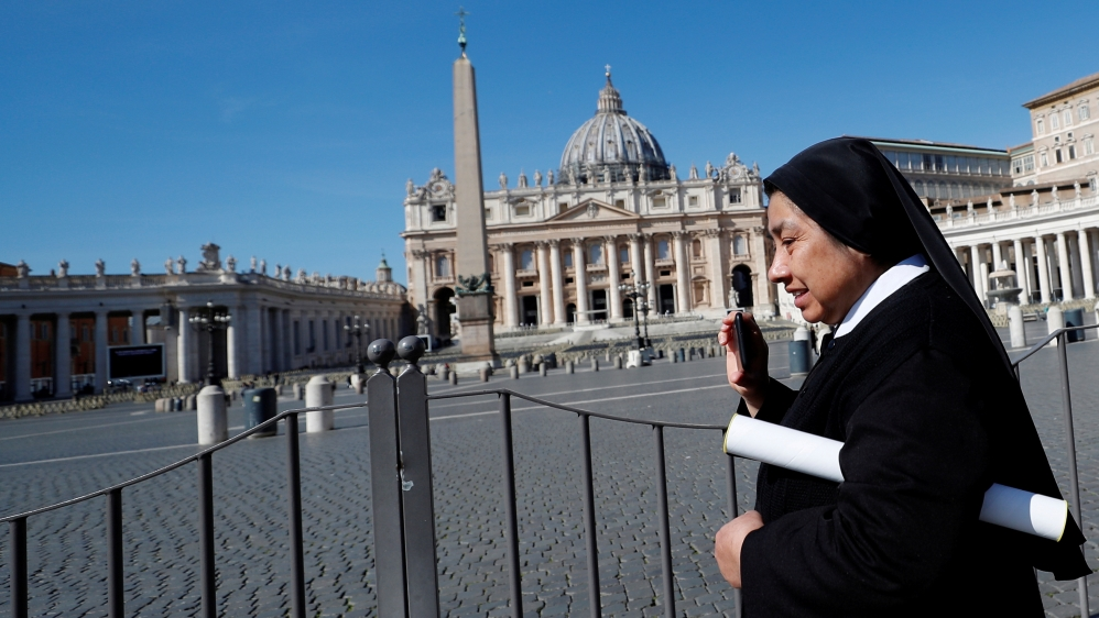 A nun walks past deserted St. Peter's Square after a decree orders for the whole of Italy to be on lockdown in an unprecedented clampdown aimed at beating the coronavirus, in Rome