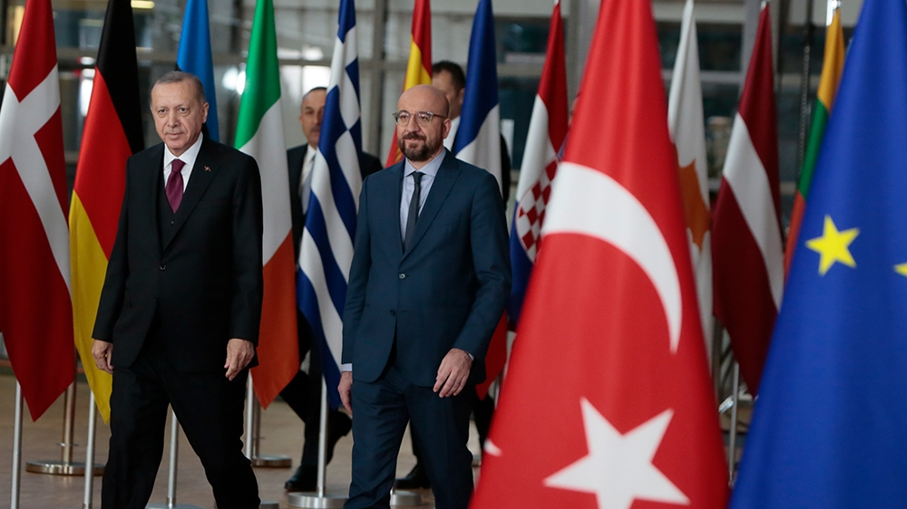 Turkish President Recep Tayyip Erdogan, left, walks with European Council President Charles Michel prior to a meeting at the European Council building in Brussels, Monday, March 9, 2020. Turkish Presi
