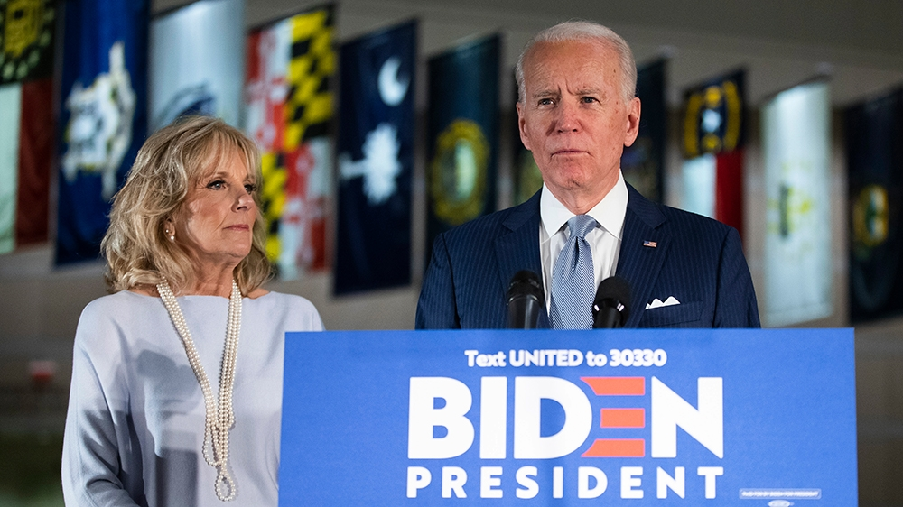 Democratic presidential candidate former Vice President Joe Biden, accompanied by his wife Jill, speaks to members of the press at the National Constitution Center in Philadelphia, Tuesday, March 10,