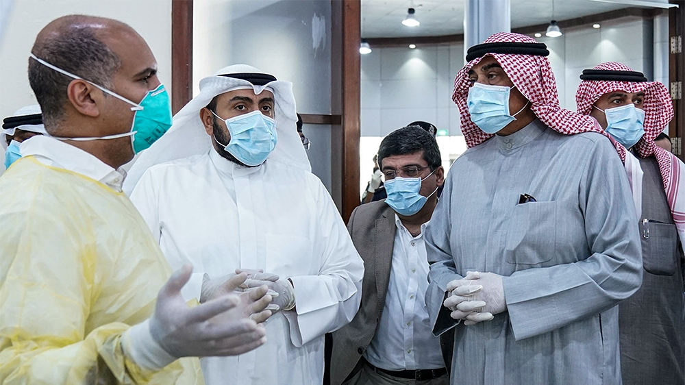 A photo provided by the Kuwaiti news agency KUNA on March 13, 2020 shows Kuwait's Prime Minister Sheikh Sabah al-Khaled al-Sabah (2nd-R), Health Minister Sheikh Basel al-Sabah (2nd-L), and Interior Mi