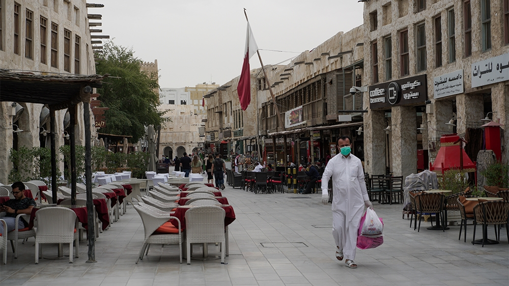 People wearing protective masks in Souq Waqif as the number of coronavirus cases has increased by 17 on, Doha, Qatar, Saturday, March 14, 2020 [Sorin Furcoi/Al Jazeera]