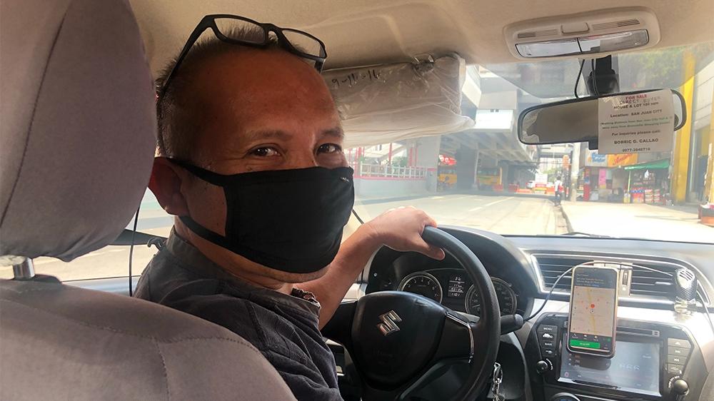 Manila lockdown Bobric Callao Cab Driver [Ana P Santos/Al Jazeera]