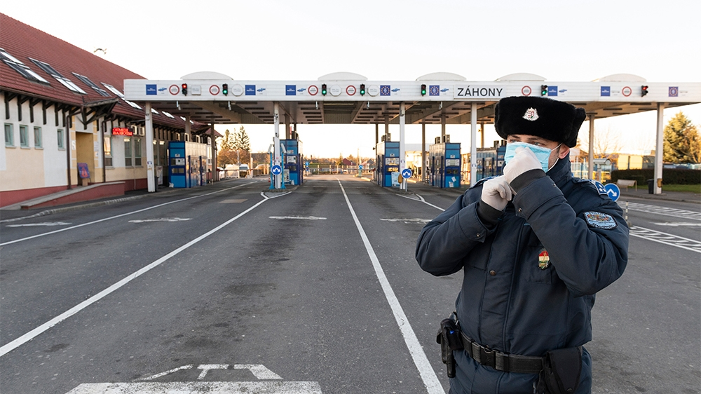 epa08295360 A Hungarian policeman wears a protictive face mask at the border crossing into Ukraine in Zahony, northeastern Hungary, 15 March 2020. The Ukrainian authorities have closed their county bo