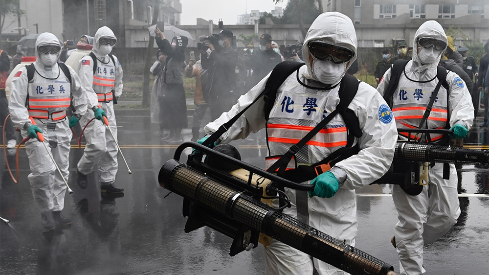 Soldiers from the militaryi´s chemical units take part in a drill organised by the New Taipei City government to prevent the spread of the COVID-19 coronavirus, in Xindian district on March 14, 2020.