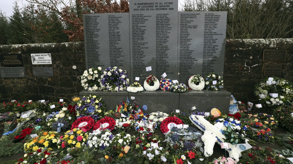 A general view of floral tributes which have been laid by the main memorial stone in memory of the victims of Pan Am flight 103 bombing, in the garden of remembrance at Dryfesdale Cemetery, near Locke
