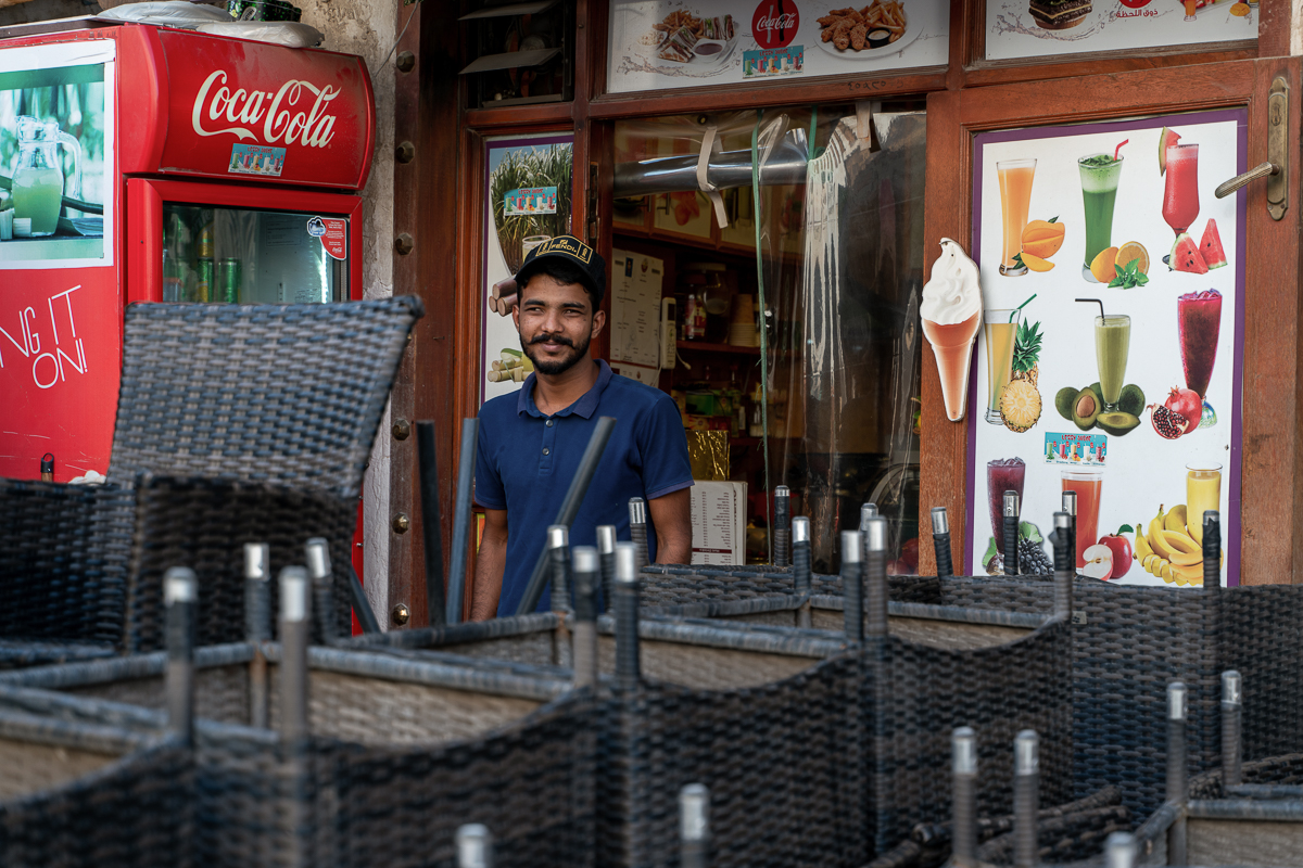 """On a very quiet day, we used to get 150 people. On weekends it was double that. Today we had two customers all day,"" said Riyaz Ijju, a barista. [Sorin Furcoi/Al Jazeera]"