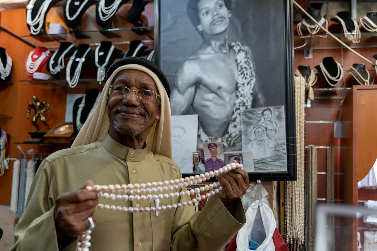 """We used to see a lot of customers, including tourists from cruise ships. But that has stopped now. I don't think this will end any time soon. Maybe the virus outbreak will last a year. I hope not but no one knows,"" said Saad Ismail, a pearl seller. [Sorin Furcoi/Al Jazeera]"