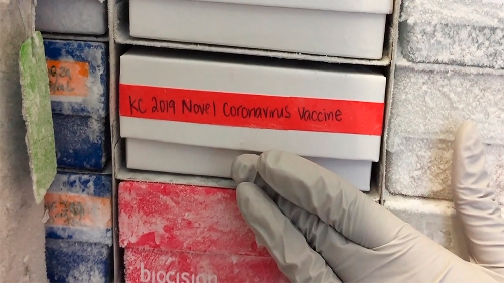 In this undated frame from video provided by the National Institute of Allergy and Infectious Diseases (NIAID), a scientist returns a novel coronavirus vaccine sample to a freezer in Bethesda, Md. The