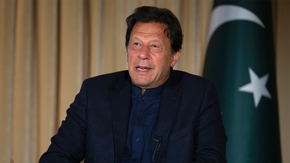 Pakistan's Prime Minister Imran Khan speaks to The Associated Press, in Islamabad, Pakistan, Monday, March 16, 2020. Khan said Monday he fears the new coronavirus will devastate developing nations' ec
