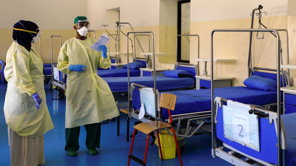 A Somali doctor and a nurse wear protective face masks as they prepare a ward for coronavirus disease (COVID-19) patients, at the Martini Hospital in Mogadishu