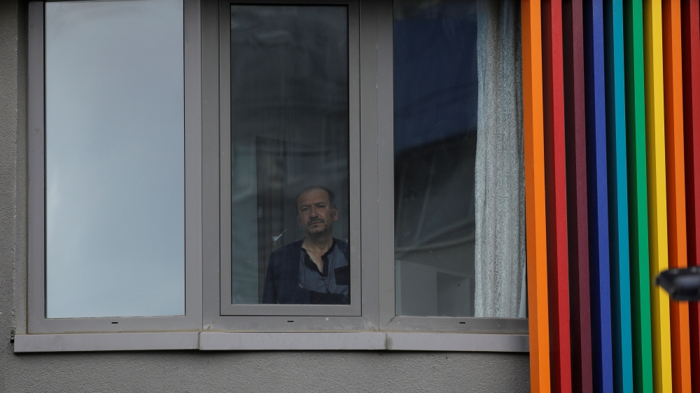 Man looks out from a dormitory where he is placed under quarantine in Istanbul