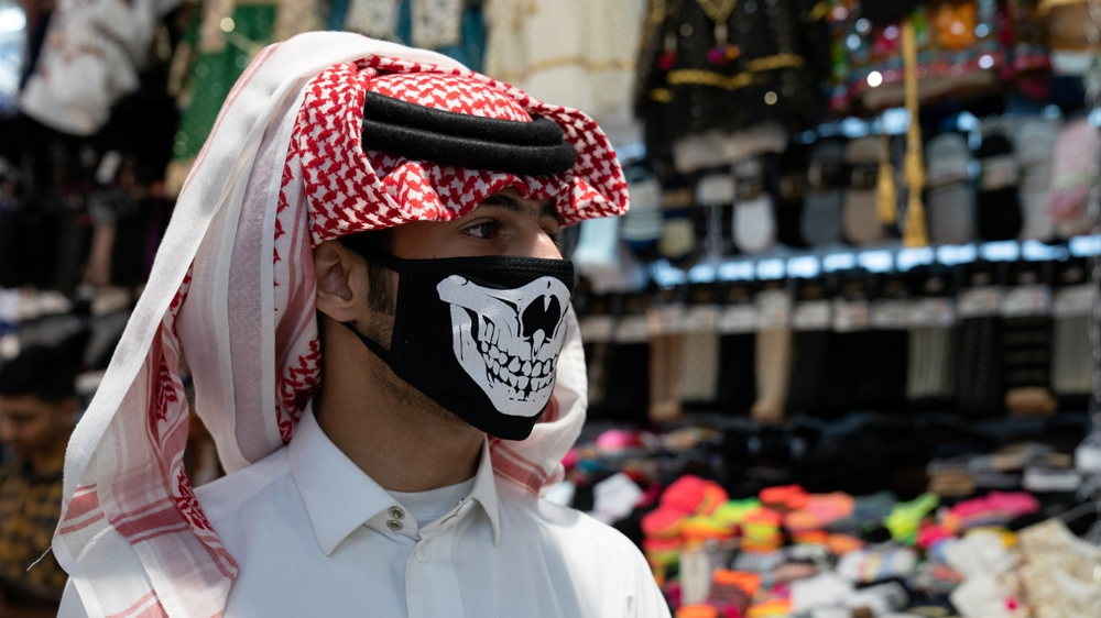 A man wears protective face mask, following the outbreak of the new coronavirus, in Kuwait, February 25, 2020. Picture taken February 25, 2020. REUTERS/Stephanie McGehee