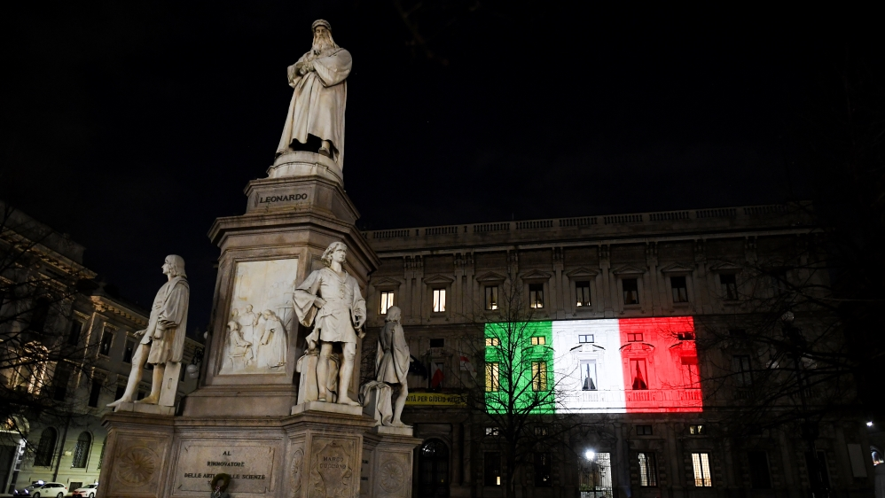 The Palazzo Marino building is seen iluminated with the colours of the Italian flag as the spread of coronavirus disease (COVID-19) continues, in Milan