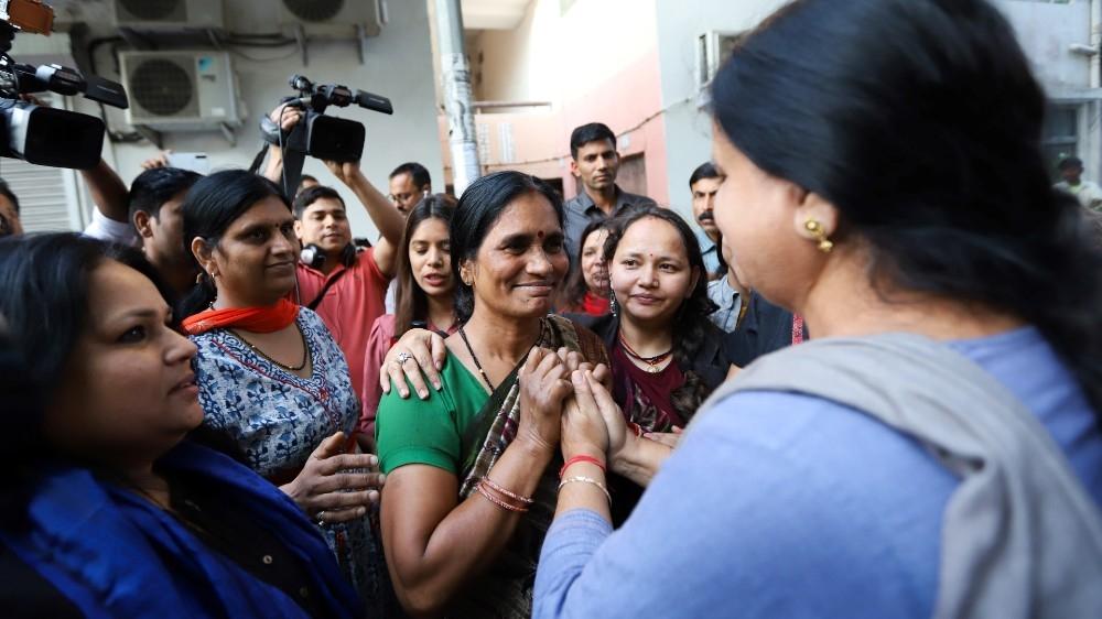 Asha Devi (C), the mother of a gang-rape victim, India