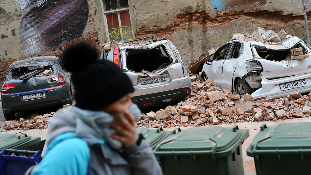 Damaged cars are seen following an earthquake, in Zagreb, Croatia March 22, 2020. REUTERS/Antonio Bronic