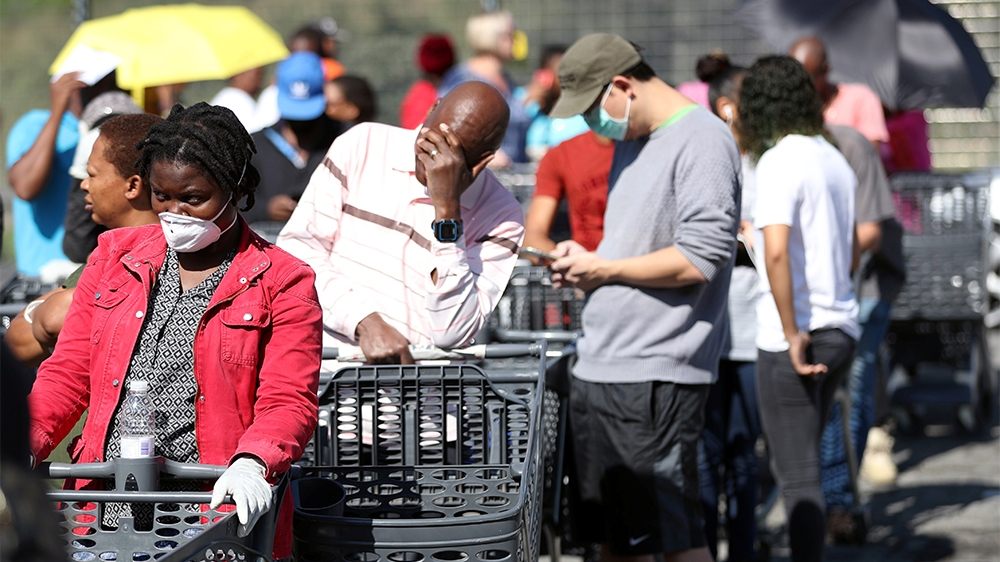 Shoppers queue to stock up on groceries at a Pick n Pay store during a nationwide lockdown of 21 days to try to contain the coronavirus disease (COVID-19) outbreak, in Johannesburg, South Africa, Marc