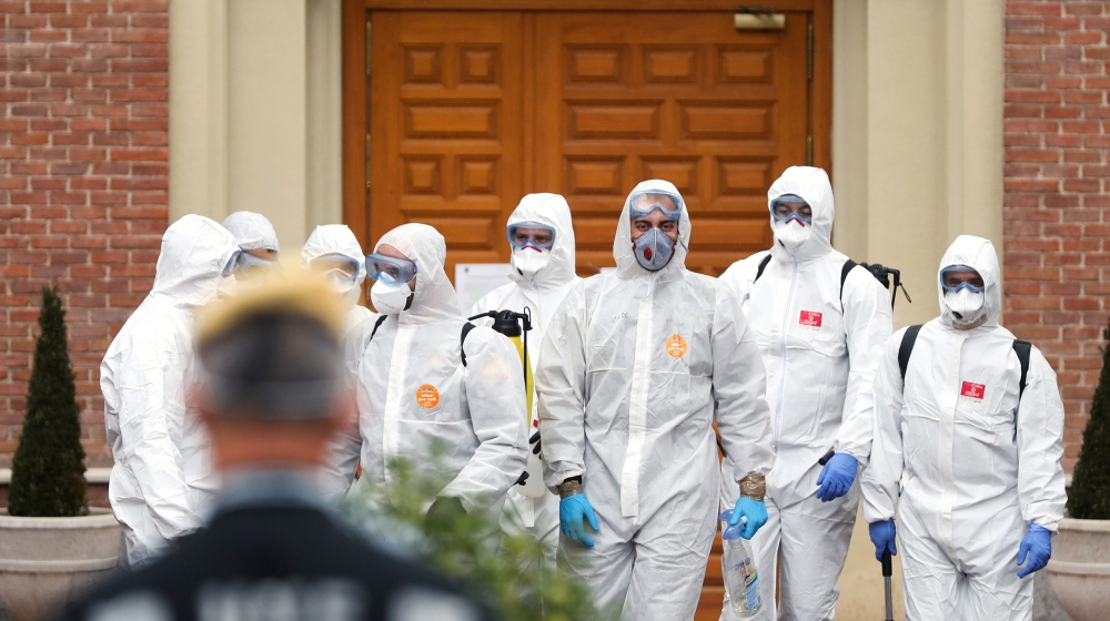 Members of the Military Emergency Unit (UME) leave an elderly home after carrying out disinfection procedures during the coronavirus disease (COVID-19) outbreak in Madrid, Spain March 23, 2020. REUTER