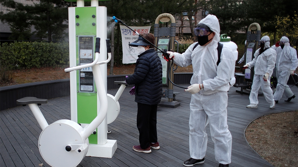 Residents of Bukgajwa1dong, wearing protective gears disinfect as a precaution against the new coronavirus at a park in Seoul, South Korea, Monday, March 23, 2020. For most people, the new coronavirus