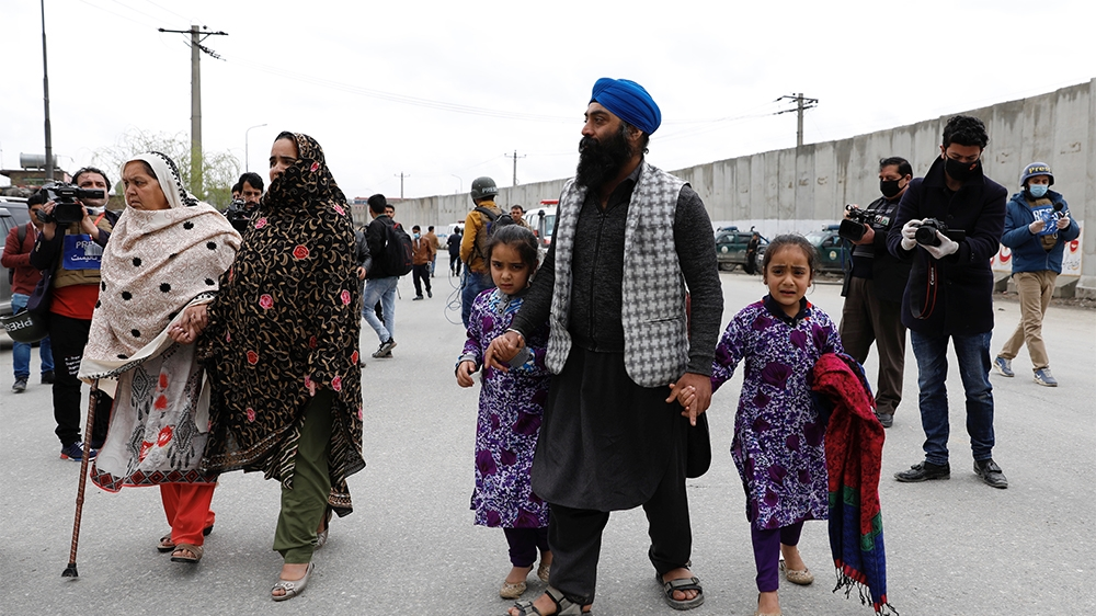 An Afghan Sikh family arrive to see their relatives near the site of an attack in Kabul, Afghanistan March 25, 2020.REUTERS/Mohammad Ismail