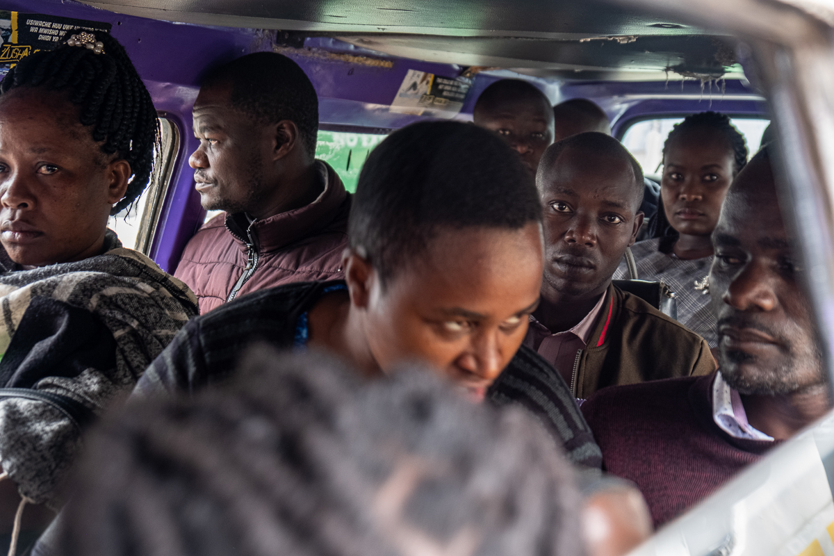 The smaller matatus, which are modified minivans, can carry up to 20 passengers. [Joost Bastmeijer/Al Jazeera]