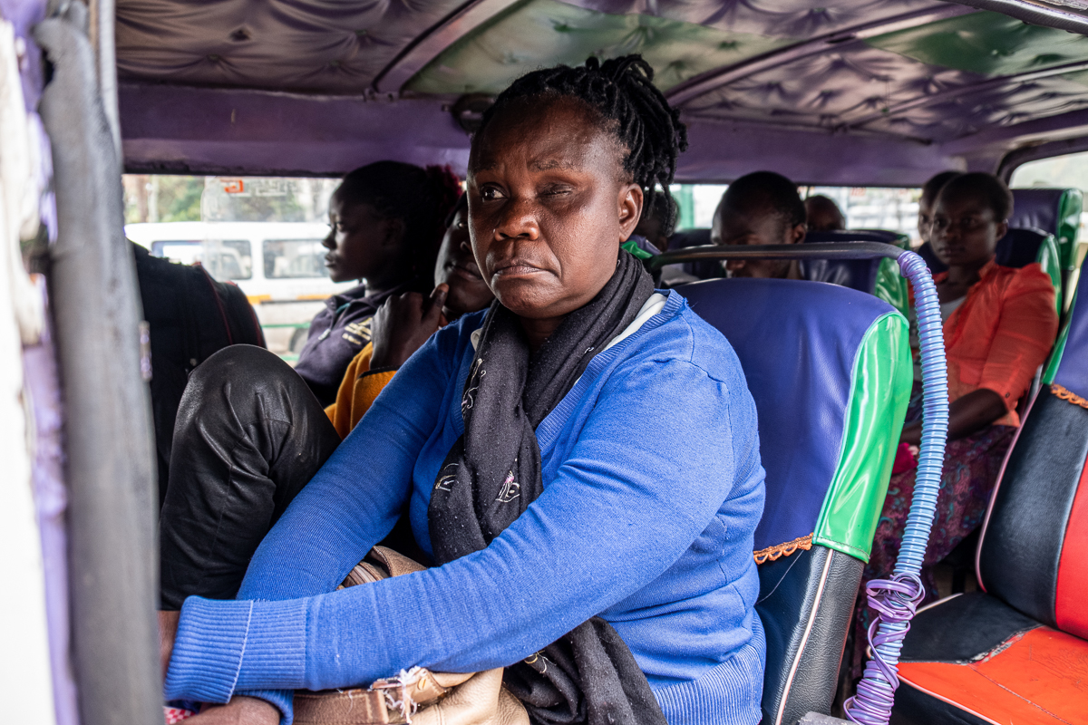 Passengers wait for the matatu to fill up and leave. Kenyan officials have said that matatu occupancy can be no more than 60 percent, to help contain the coronavirus outbreak. [Joost Bastmeijer/Al Jazeera]