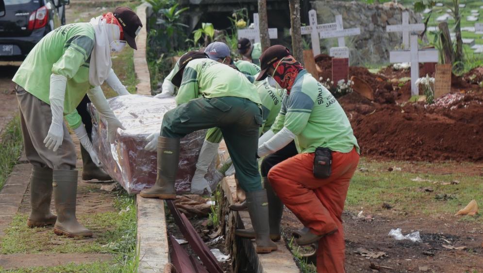 Burial for coronavirus victims in Indonesia
