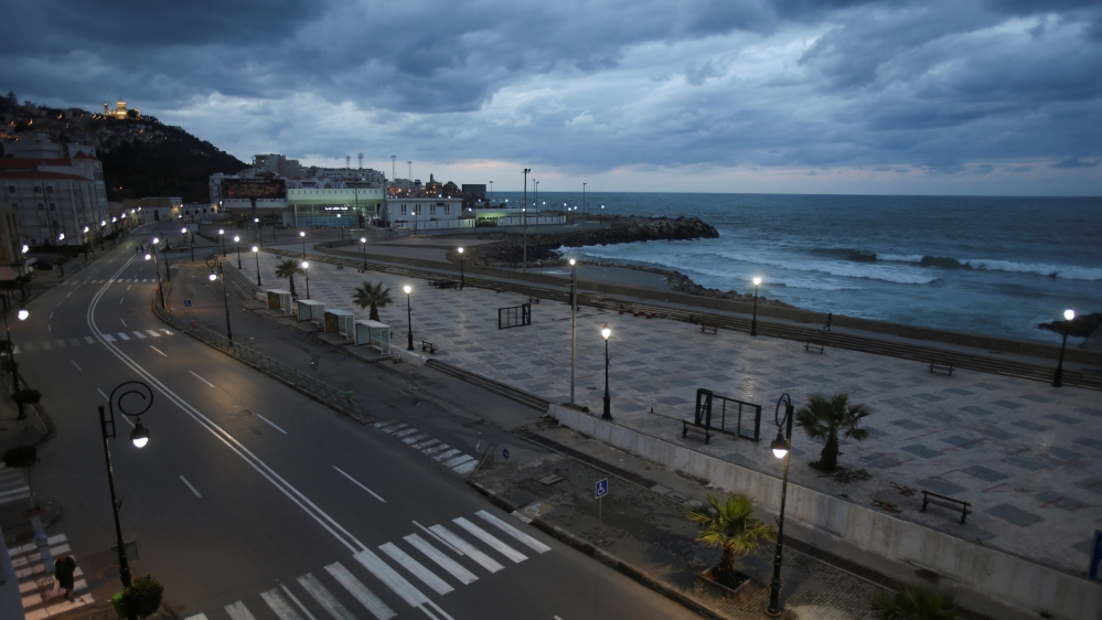 A general view shows an empty street after a curfew was imposed from 7pm-7am to prevent the spread of the coronavirus disease (COVID-19), in Algiers