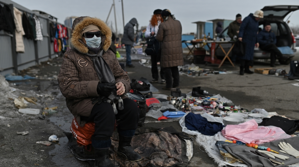 A vendor waits for customers at a flea market in Omsk