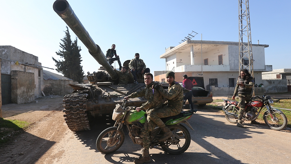 Turkish backed Syrian rebels enter the own of Saraqeb, in Idlib province, Syria, Thursday, Feb. 27, 2020. Turkey-backed Syrian opposition fighters Thursday retook a strategic northwestern town iof Sar