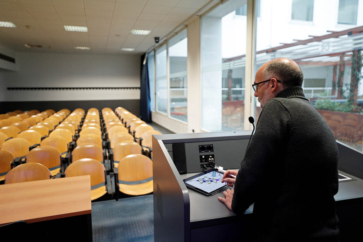 University professor Luca De Gioia records his lecture in an empty classroom to stream online for his students at Bicocca University, Milan. Italian authorities have closed schools and universities in Lombardy and northern regions in order to prevent the spread of the novel coronavirus. [Guglielmo Mangiapane/Reuters]