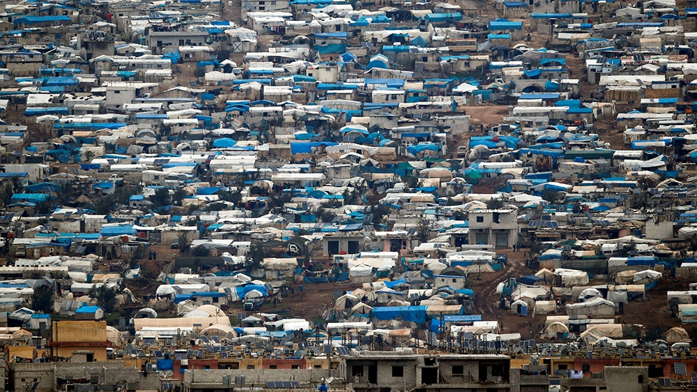 Tents housing internally displaced people in Atma camp in Idlib Governorate of Syria are seen on the Syrian side of the border zone near the Turkish village of Bukulmez in Hatay province, Turkey, Febr