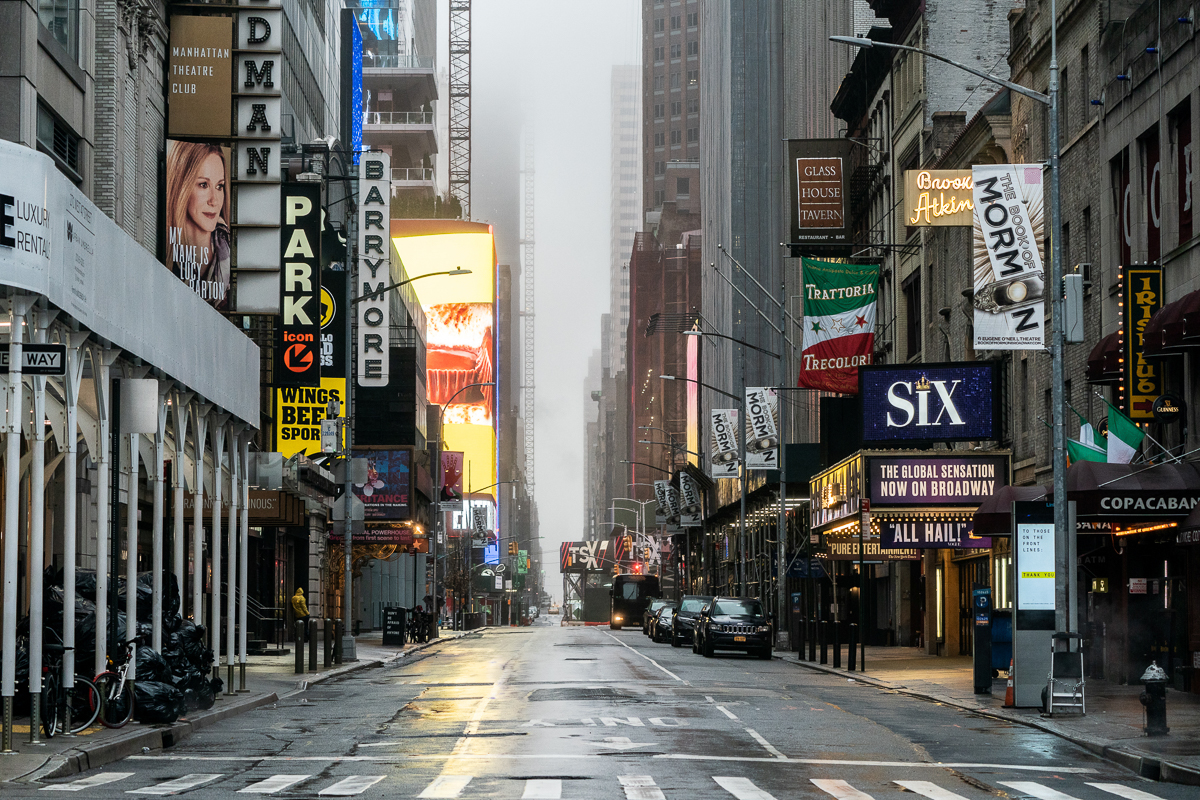 The Broadway theatre district has emptied. So far 930 members of the New York Police Department have tested positive for the disease. [Jeenah Moon/Reuters]