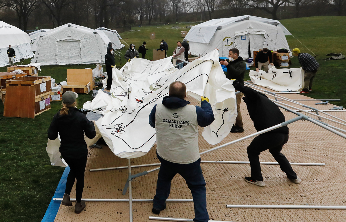 Field tents are erected as a makeshift hospital in the East Meadow of Central Park by the disaster relief organisation, Samaritan's Purse. New York City is the epicentre of the coronavirus in the US. [Peter Foley/EPA]