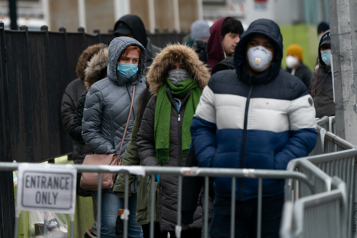 People wait in line to be tested for the coronavirus outside Elmhurst Hospital Center in Queens. [Jeenah Moon/Reuters]