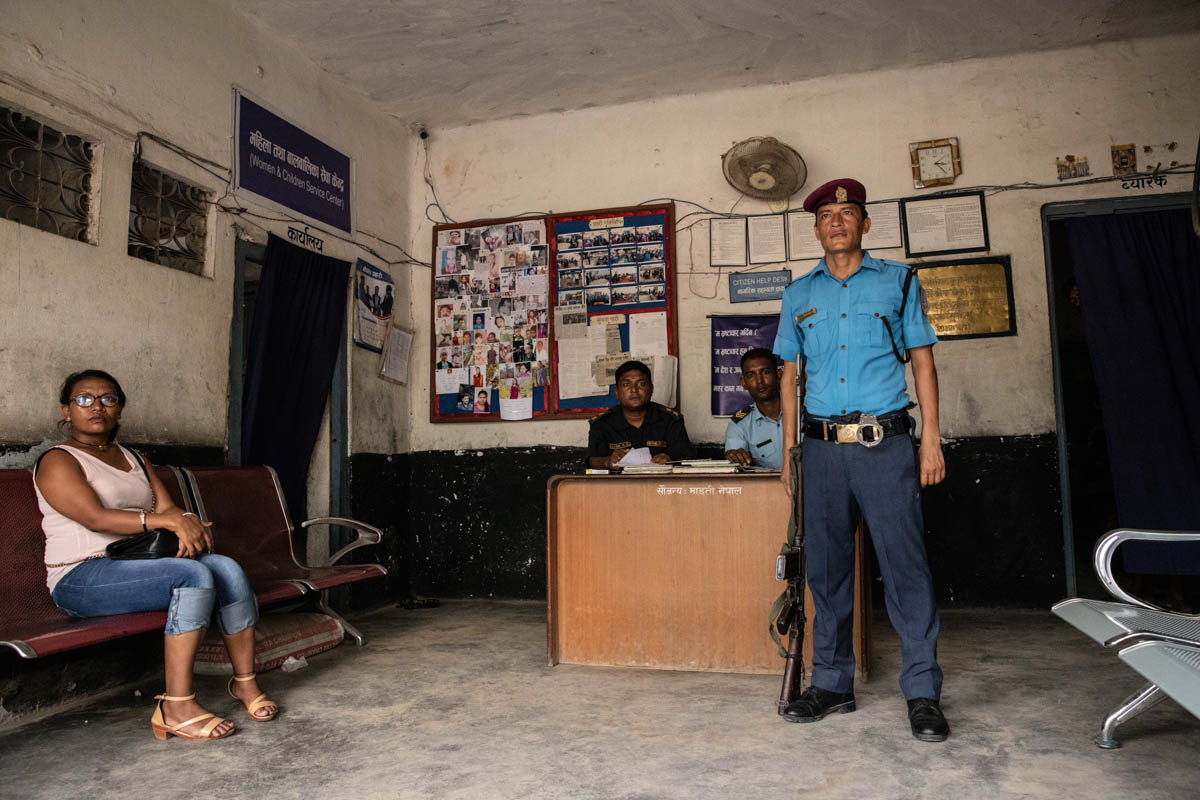 Police officers at the station in Bhairahawa. One of their tasks is to prevent human trafficking from Nepal into India by coordinating efforts with anti-trafficking NGO border monitors trying to identify and rescue possible victims. Anti-trafficking NGOs also run their own monitoring booths along the border amid a shortage of official monitoring stations. [Violeta Santos Moura/Al Jazeera]