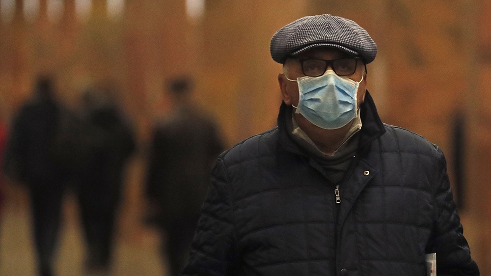 epa08267476 A passenger wearing a protective face mask travels on a Metro in Moscow, Russia, 03 March 2020. People with symptoms of acute viral respiratory infections who arrived to Moscow from countr